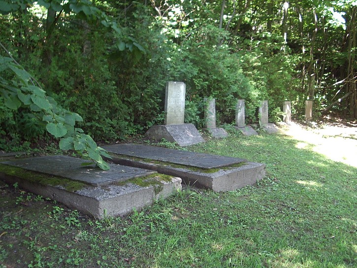 small cemetery right next to the path