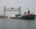 Ship passing under a lift bridge in the Welland Canal