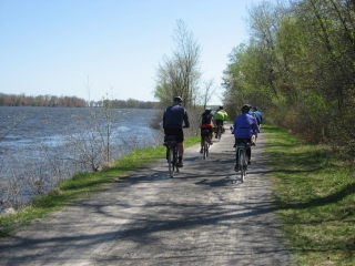 cyclists riding on crushed stone path