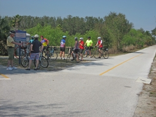 group of cyclists stop for a rest on the Legacy Trail