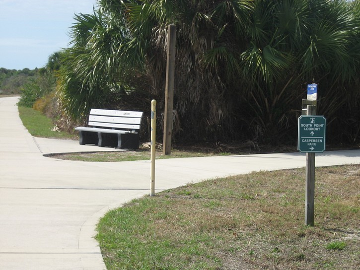bench and a sign to the Caspersen Park