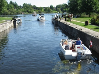 boats going through the Black Rapids lock