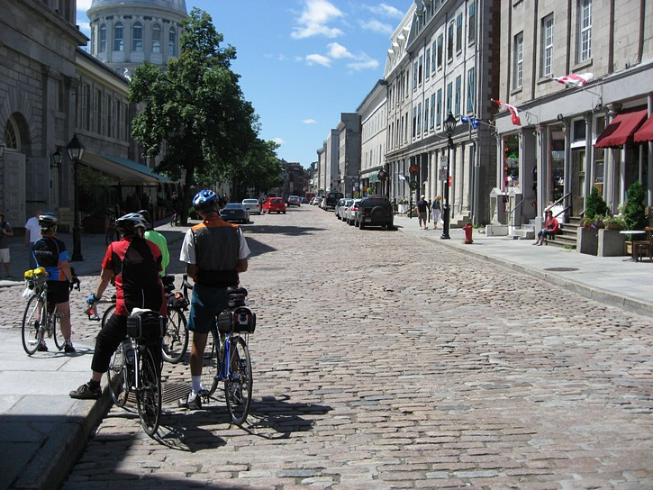 cyclists on Rue Saint Paul in Old Montreal.