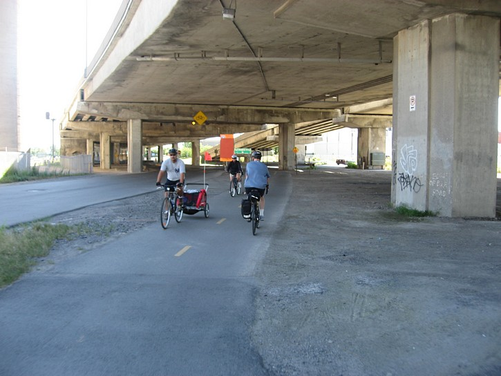 cycling on path under the Bonaventure Expressway