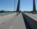 cyclists on bridge to Île Notre-Dame