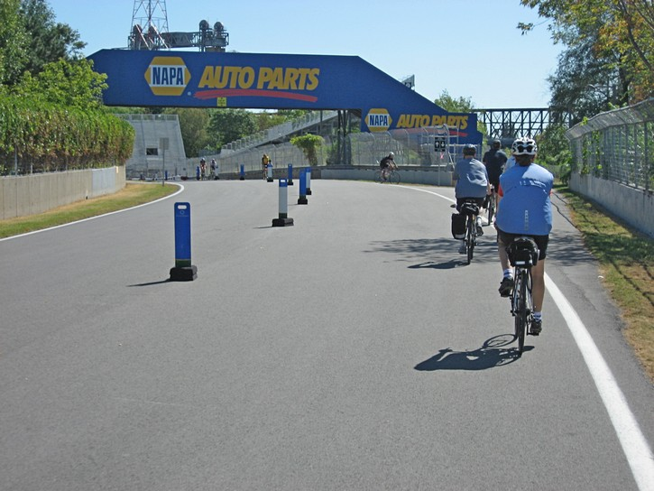 Cyclists on the Gilles Villeneuve Formula One race circuit