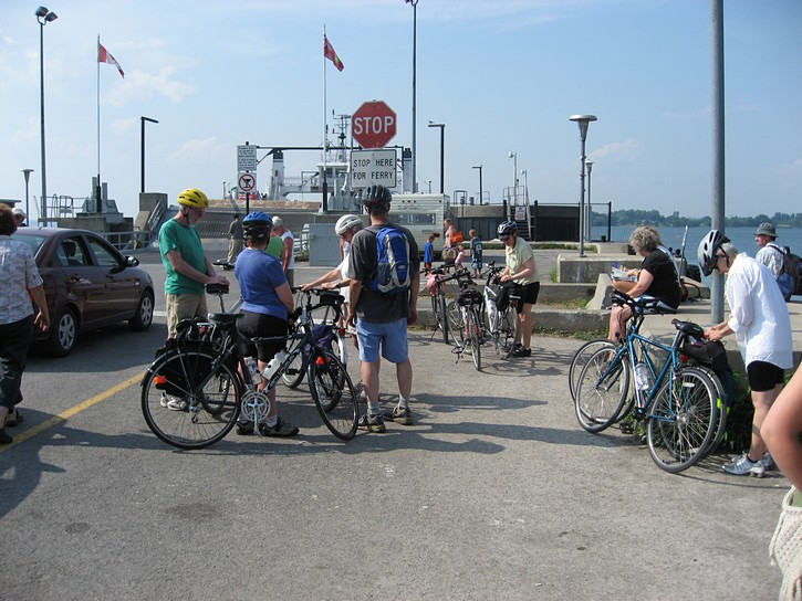 Cyclists waiting to take the ferry on Wolfe Island.