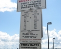 sign with ferry schedule and fees