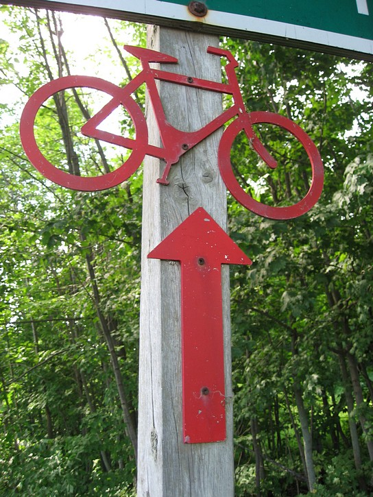 a sign for a bicycle route on Wolfe Island.